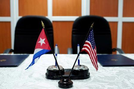 FILE PHOTO: A view of the U.S. and Cuban flags prior to the signing of agreements between the Port of Cleveland and the Cuban Maritime authorities in Havana, Cuba, October 6, 2017. REUTERS/Alexandre Meneghini/File Photo