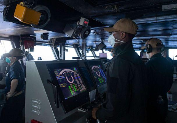 PHOTO: Seaman Cameron Davis mans the helm of the aircraft carrier USS Theodore Roosevelt (CVN 71) as the ship operates in the Philippine Sea, May 21, 2020, following an extended visit to Guam in the midst of the COVID-19 global pandemic. (Mc3 Zachary Wheeler/U.S. Navy)