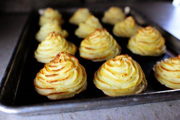 """<p>These piped potatoes are almost too beautiful to eat! They're a great way to step up your potato side dish game for a holiday.</p><p><a href=""""https://www.thepioneerwoman.com/food-cooking/recipes/a10444/duchess-potatoes/"""" rel=""""nofollow noopener"""" target=""""_blank"""" data-ylk=""""slk:Get the recipe."""" class=""""link rapid-noclick-resp""""><strong>Get the recipe.</strong></a></p><p><a class=""""link rapid-noclick-resp"""" href=""""https://go.redirectingat.com?id=74968X1596630&url=https%3A%2F%2Fwww.walmart.com%2Fsearch%2F%3Fquery%3Dpioneer%2Bwoman%2Bcookware&sref=https%3A%2F%2Fwww.thepioneerwoman.com%2Ffood-cooking%2Fmeals-menus%2Fg35514088%2Fbest-side-dishes-for-ham%2F"""" rel=""""nofollow noopener"""" target=""""_blank"""" data-ylk=""""slk:SHOP COOKWARE"""">SHOP COOKWARE</a></p>"""