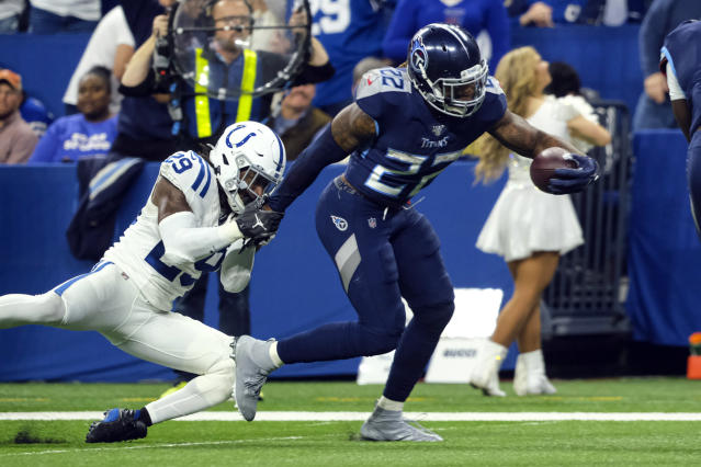 Tennessee Titans running back Derrick Henry (22) breaks the tackle of Indianapolis Colts free safety Malik Hooker (29) on his way to a touchdown during the second half of an NFL football game in Indianapolis, Sunday, Dec. 1, 2019. (AP Photo/AJ Mast)