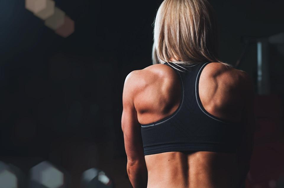 Back of woman exercising
