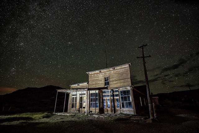 <p>Bodie's prominence did not begin to rise until 1876, when a larger deposit of gold ore drew more settlers, leaving the town with some five to seven thousand inhabitants by 1879. (Photo: Matthew Christopher — Abandoned America/Caters News) </p>