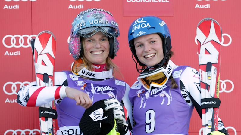 Austria's Marlies Schild, left, winner of an alpine ski, women's World Cup slalom, celebrates on the podium with her sister Bernadette Schild, who finished in third place, in Courchevel, France, Tuesday, Dec. 17, 2013. (AP Photo/Marco Tacca)