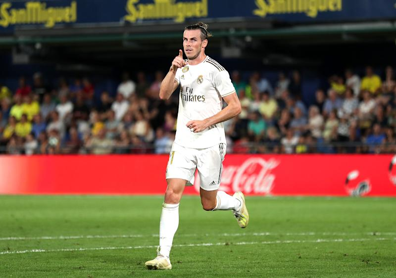 VILLAREAL, SPAIN - SEPTEMBER 01: Gareth Bale of Real Madrid celebrates after scoring his sides first goal during the Liga match between Villarreal CF and Real Madrid CF at Estadio de la Ceramica on September 01, 2019 in Villareal, Spain. (Photo by David Ramos/Getty Images)