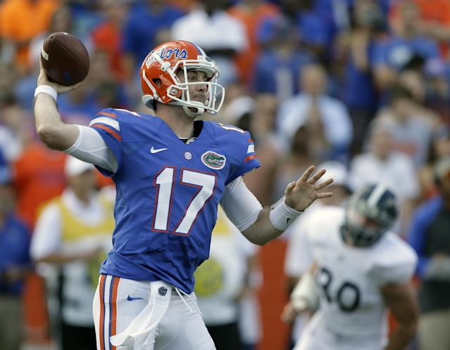 Florida quarterback Skyler Mornhinweg (17) throws a pass as he is pressured by Georgia Southern cornerback Valdon Cooper (30) during the first half of an NCAA college football game in Gainesville, Fla., Saturday, Nov. 23, 2013.(AP Photo/John Raoux)