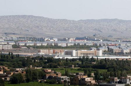 FILE PHOTO: With Xinjiang's fabled Tianshan mountains in the background, what is officially known as a vocational skills education centre is seen in Turpan