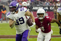 Minnesota Vikings outside linebacker Nick Vigil (59) run back an interception for a touchdown as Arizona Cardinals wide receiver Rondale Moore (4) pursues during the second half of an NFL football game, Sunday, Sept. 19, 2021, in Glendale, Ariz. (AP Photo/Rick Scuteri)