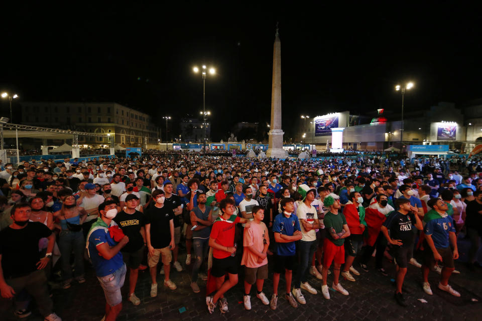 Italy supporters watch the Euro 2020 group A soccer match between Italy and Switzerland on a giant screen in Rome's central Piazza del Popolo, Wednesday, June 16, 2021. (Cecilia Fabiano/LaPresse via AP)