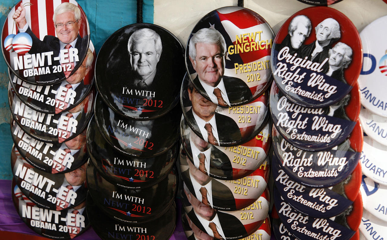 Campaign buttons are for sale by a vendor outside Mama Lou's restaurant in Robertsdale, Ala., Saturday March 10, 2012, during a campaign stop by Republican presidential candidate and former House Speaker Newt Gingrich. (AP Photo/ John David Mercer)