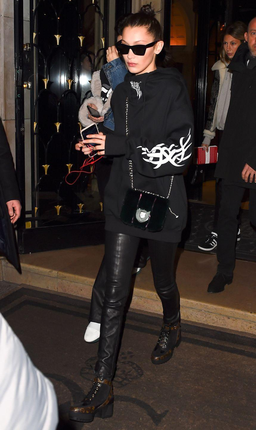 <p>In a black Dolls Kill sweatshirt, fur crossbody bag, leather leggings, Louis Vuitton lace-up boots and Céline sunglasses while out in Paris.</p>
