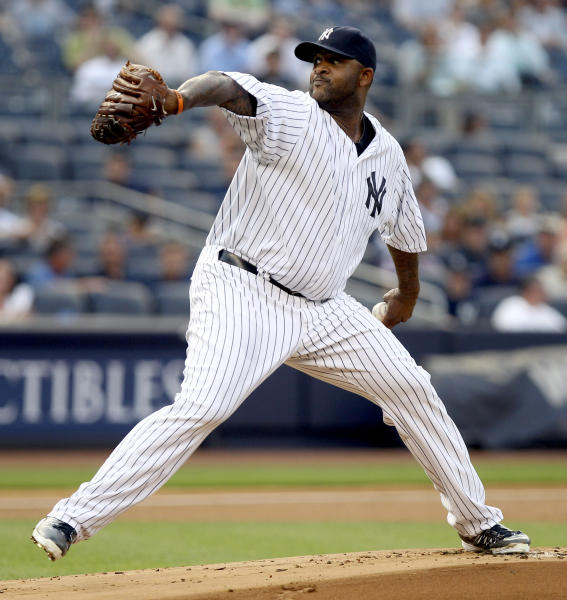 New York Yankees starting pitcher CC Sabathia delivers during the first inning of a baseball game against the Toronto Blue Jays, Tuesday, July 17, 2012, at Yankee Stadium in New York. (AP Photo/Seth Wenig)