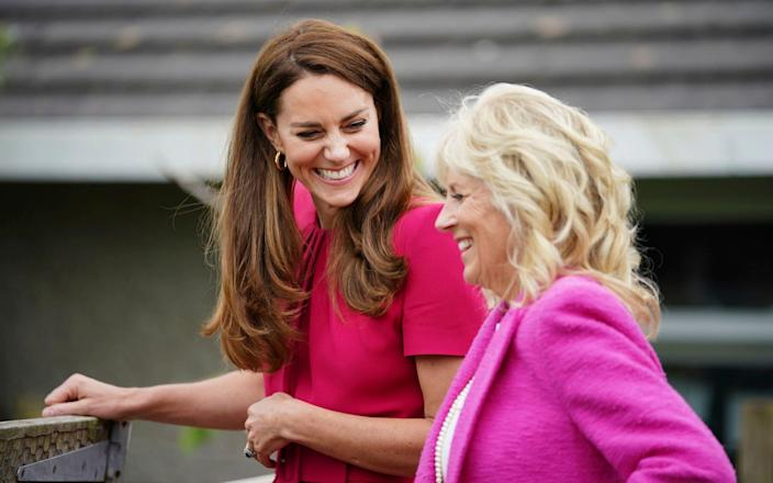 The Duchess of Cambridge and Jill Biden laugh during a visit to Connor Downs Academy in Hayle, West Cornwall, - PA