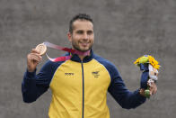 Carlos Alberto Ramirez Yepes of Colombia stands with his bronze medal in the men's BMX Racing finals at the 2020 Summer Olympics, Friday, July 30, 2021, in Tokyo, Japan. (AP Photo/Ben Curtis)