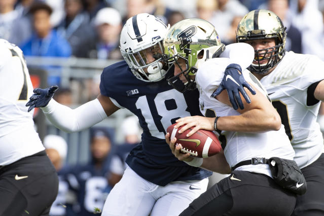 Penn State defensive end Shaka Toney (18) sacks Purdue quarterback Jack Plummer (13) in the first quarter of an NCAA college football game in State College, Pa., on Saturday, Oct. 5, 2019. (AP Photo/Barry Reeger)