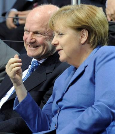 FILE PHOTO: German Chancellor Merkel chats with Piech, chairman of the supervisory board of Volkswagen during a visit at the plant of German carmaker in Wolfsburg
