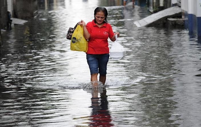 More than 1,000 lives are lost every year in the Philippines, with typhoons accounting for the majority of deaths and damage (AFP Photo/Jay Directo)