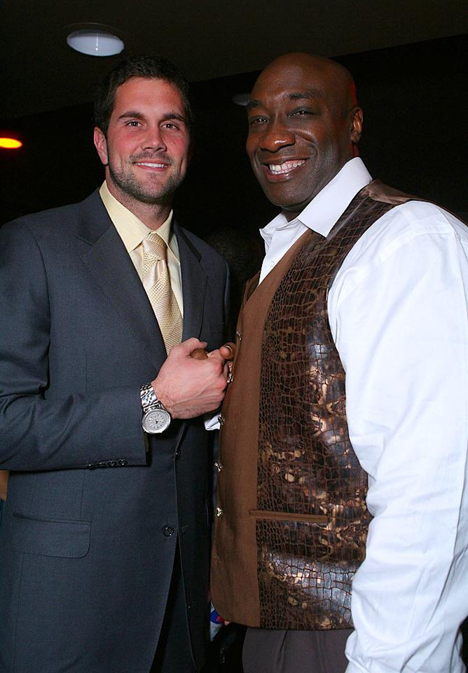 """Cards QB Matt Leinart and actor Michael Clarke Duncan shake hands at the Victoria's Secret """"What is Sexy"""" Party. Despite his immense size, Duncan's never played pro football. Instead, he practices Brazilian jiu-jitsu. Alexandra Wyman/<a href=""""http://www.wireimage.com"""" target=""""new"""">WireImage.com</a> - February 2, 2008"""