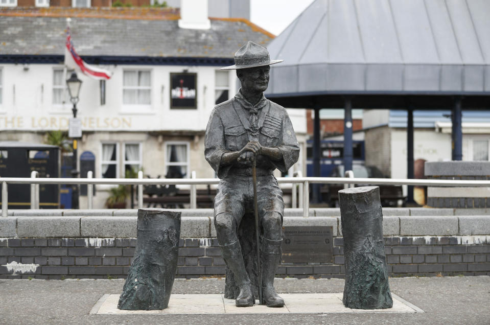 """A statue of the founder of the Scout movement Robert Baden-Powell on Poole Quay in Dorset, England ahead of its expected removal to """"safe storage"""" following pressure to remove it over concerns about his alleged actions while in the military and """"Nazi sympathies"""" Thursday June 11, 2020. (Andrew Matthews/PA via AP)"""