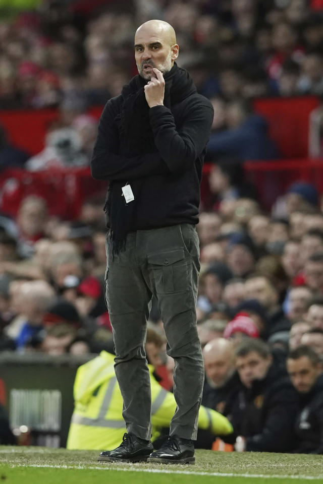 Manchester City's head coach Pep Guardiola reacts during the English Premier League soccer match between Manchester United and Manchester City at Old Trafford in Manchester, England, Sunday, March 8, 2020. (AP Photo/Dave Thompson)