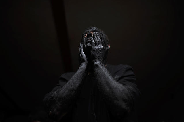 <p>A man covers his face in oil and soot as he prepares himself for a carnival festival in the small village of Luzon, Spain, March 1, 2014. (AP Photo/Andres Kudacki) </p>