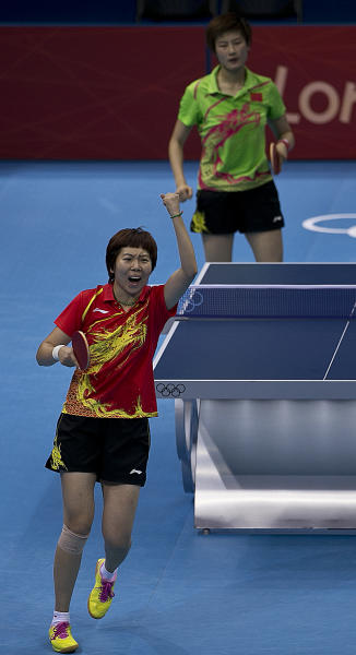 China's Li Xiaoxia reacts as she defeats China's Ding Ning in the gold medal round of women's table tennis at the 2012 Summer Olympics, Wednesday, Aug. 1, 2012, in London. (AP Photo/Charlie Riedel)