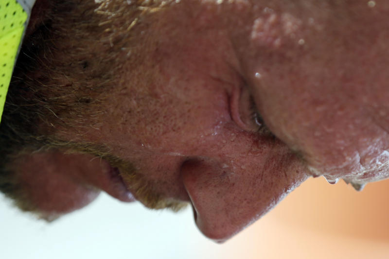 FILE - In this July 6, 2012 file photo, perspiration collects on construction worker David Macmullen's face in the afternoon heat, Friday, July 6, 2012, in Philadelphia. Federal scientists say July was the hottest month ever recorded in the Lower 48 states, breaking a record set during the Dust Bowl of the 1930s. The average temperature last month was 77.6 degrees. That breaks the old record from July 1936 by 0.2 degree, according to the National Oceanic and Atmospheric Administration. Records go back to 1895. (AP Photo/Matt Rourke)