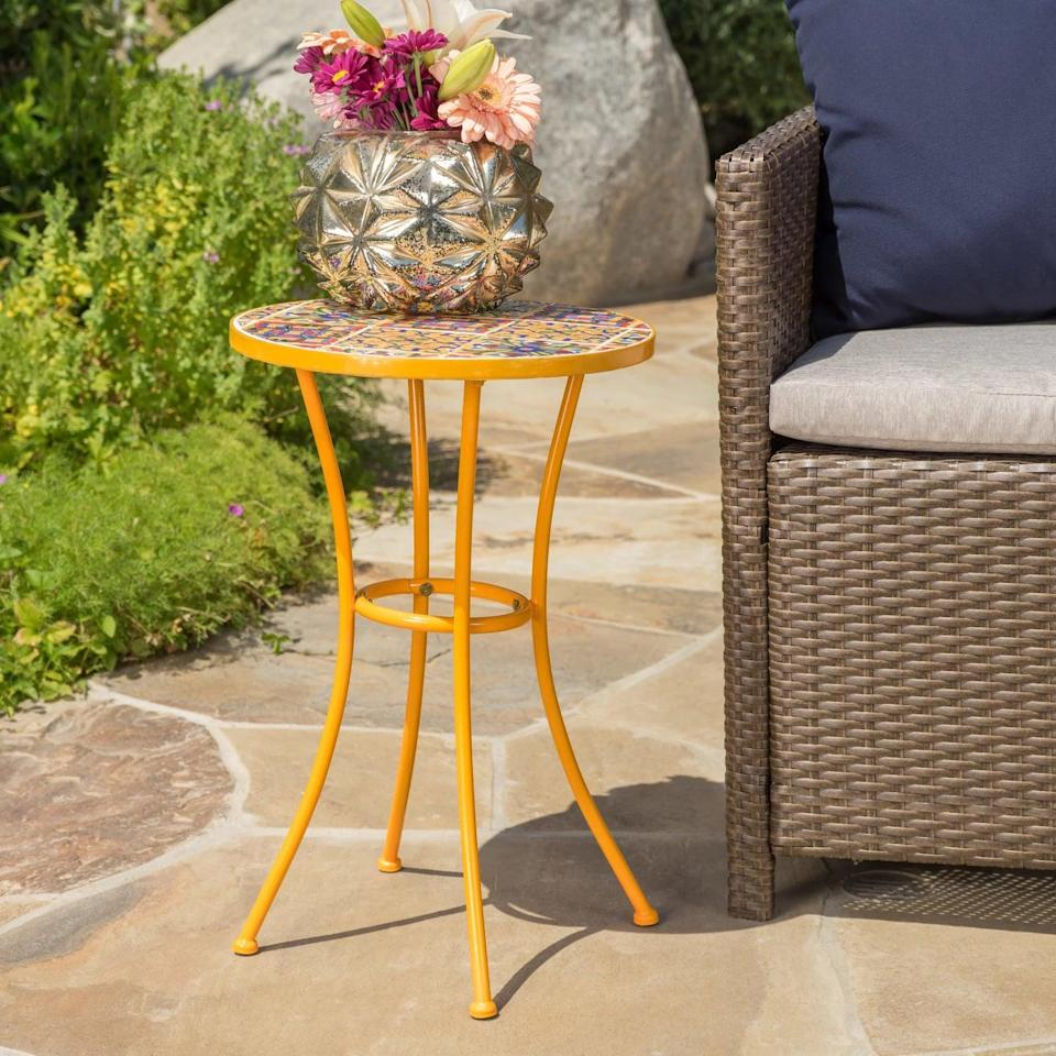 <p>Add a dash of color to your decor with the bold, Mediterranean-inspired <span>Christopher Knight Home Barnsfield Ceramic Tile Side Table - Yellow</span> ($35).</p>