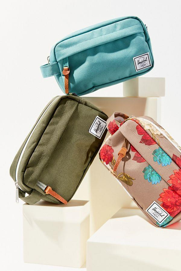 "<h3>Herschel Supply Co. Chapter Carry-On Travel Kit </h3><br><strong>The Makeup Bag Organizer</strong><br><br>Looking for a downsized option? Herschel's candy-colored dopp kits feature a mesh storage sleeve, outer pocket, and roomy main compartment for all your essentials.<br><br><strong>The Hype: </strong>4.9 out of 5 stars and 60 reviews on <a href=""https://www.urbanoutfitters.com/shop/herschel-supply-co-chapter-carry-on-travel-kit"" rel=""nofollow noopener"" target=""_blank"" data-ylk=""slk:Urban Outfitters"" class=""link rapid-noclick-resp"">Urban Outfitters</a><br><br><strong>Organization Obsessives Say: </strong>""I do a decent amount of traveling for work and for fun, and this thing has held up very well! Very sturdy and still cute. Holds everything you need, make up, tooth brush, perfume, extra tampons.. great bag."" — Kinzi, Urban Outfitters Reviewer<br><br><strong>Herschel Supply Co.</strong> Chapter Carry-On Travel Kit, $, available at <a href=""https://go.skimresources.com/?id=30283X879131&url=https%3A%2F%2Fwww.urbanoutfitters.com%2Fshop%2Fherschel-supply-co-chapter-carry-on-travel-kit"" rel=""nofollow noopener"" target=""_blank"" data-ylk=""slk:Urban Outfitters"" class=""link rapid-noclick-resp"">Urban Outfitters</a>"
