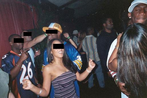 Nevin Shapiro and a second source said this photo was taken in the booster's VIP section of a club in 2004. Antrel Rolle is pictured at the right margin dancing with a female companion. Behind him, standing in a dark shirt and glasses, is one of Shapiro's former bodyguards.