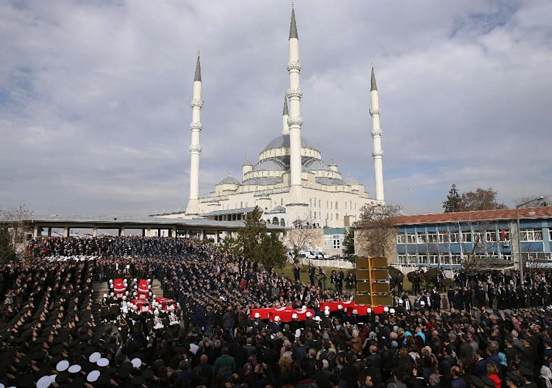 Honour guards carry the Turkish flag-draped coffins of car bombing victims during a funeral ceremony at Kocatepe Mosque in Ankara (AFP Photo/Adem Altan)
