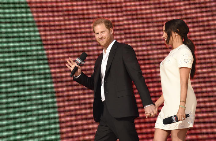 Prince Harry, the Duke of Sussex, left, and Meghan, the Duchess of Sussex appear at Global Citizen Live in Central Park on Saturday, Sept. 25, 2021, in New York. (Photo by Evan Agostini/Invision/AP)