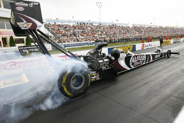In this photo provided by NHRA, Top Fuel driver Shawn Langdon powered his Al-Anabi Racing dragster to victory Sunday, Oct. 6, 2013, at Maple Grove Raceway, Mohnton, Pa., for the Auto-Plus NHRA Nationals. This marks his sixth win in 2013, seventh of his career and first-ever win at Maple Grove Raceway. (AP Photo/ Randy Anderson)