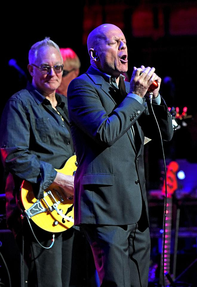 """<p>Actor Bruce Willis showed off one of his other talents at the all-star """"Love Rocks"""" concert in New York City, to raise money for God's Love We Deliver, an organization that delivers meals to the area's severely ill. The """"Respect Yourself"""" singer spent part of his time playing harmonica and harp behind other artists. (Photo: Derek Storm/Splash News) </p>"""