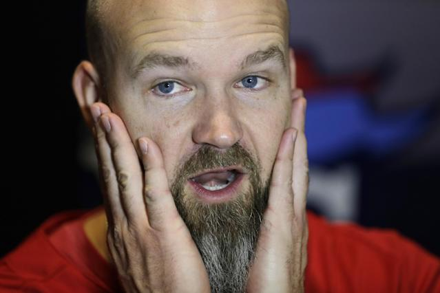 Boston Red Sox's David Ross rubs his beard during a news conference at Fenway Park Tuesday, Oct. 22, 2013, in Boston. The Red Sox are scheduled to host the St. Louis Cardinals in Game 1 of baseball's World Series on Wednesday. (AP Photo/Charles Krupa)