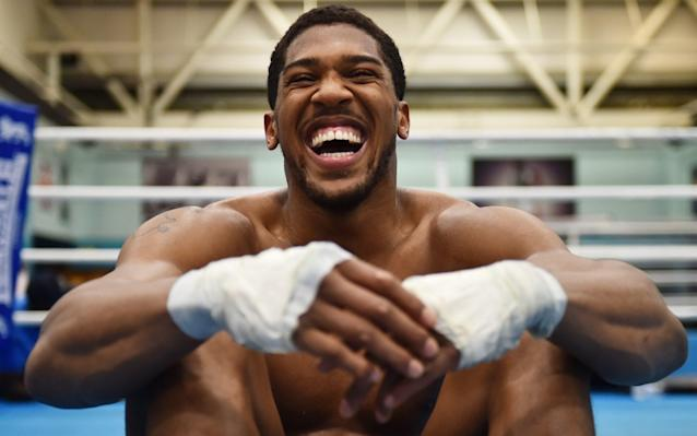 <span>Jolly giant: AJ during a break from working out</span> <span>Credit: Getty </span>