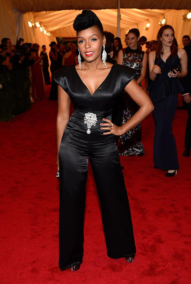 R&B singer Janelle Monae, who usually goes for more masculine looks, opted for a black pant suit accented with a gemstone brooch at the waist and matching earrings.