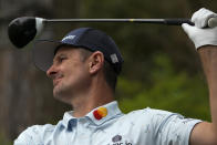 Justin Rose, of England, watches his tee shot on the 14th hole during the first round of the Masters golf tournament on Thursday, April 8, 2021, in Augusta, Ga. (AP Photo/Charlie Riedel)