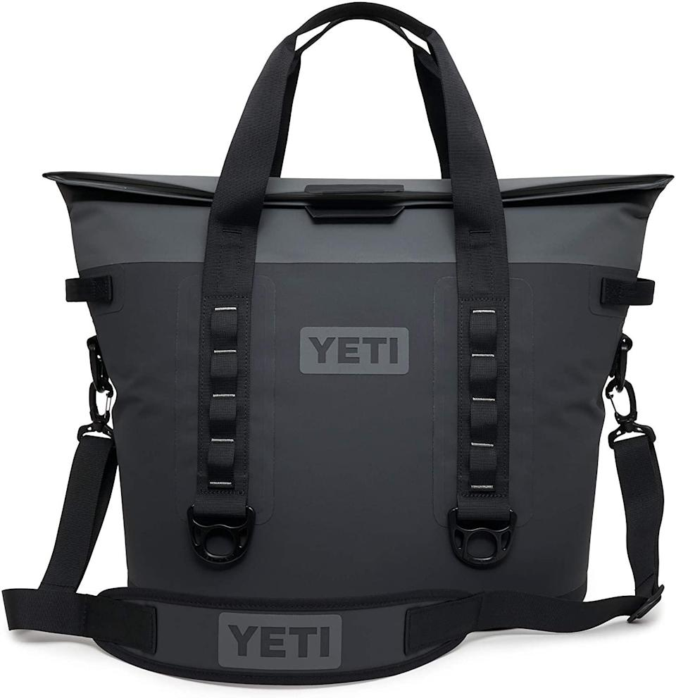 "Behold the dad version of <a href=""https://www.glamour.com/gallery/best-work-bags?mbid=synd_yahoo_rss"" rel=""nofollow noopener"" target=""_blank"" data-ylk=""slk:the catchall tote"" class=""link rapid-noclick-resp"">the catchall tote</a>. It's spill- and hole-proof, and available for free shipping and delivery at Huckberry within one to four business days. $300, Huckberry. <a href=""https://huckberry.com/store/yeti-coolers/category/p/61449-hopper-m30"" rel=""nofollow noopener"" target=""_blank"" data-ylk=""slk:Get it now!"" class=""link rapid-noclick-resp"">Get it now!</a>"