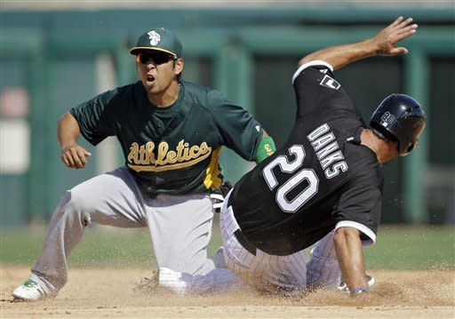 Oakland Athletics shortstop Hiroyuki Nakajima, left, tags out Chicago White Sox's Jordan Danks (20) who was attempting to steal second in the fifth inning of an exhibition spring training baseball game on Saturday, March 16, 2013, in Glendale, Ariz. (AP Photo/Mark Duncan)