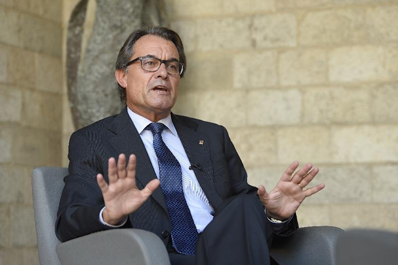 "Catalonia's nationalist president Artur Mas, tipped by opinion polls to win the vote, called on Catalans to ""Give the finger"" to their opponents (AFP Photo/Lluis Gene)"