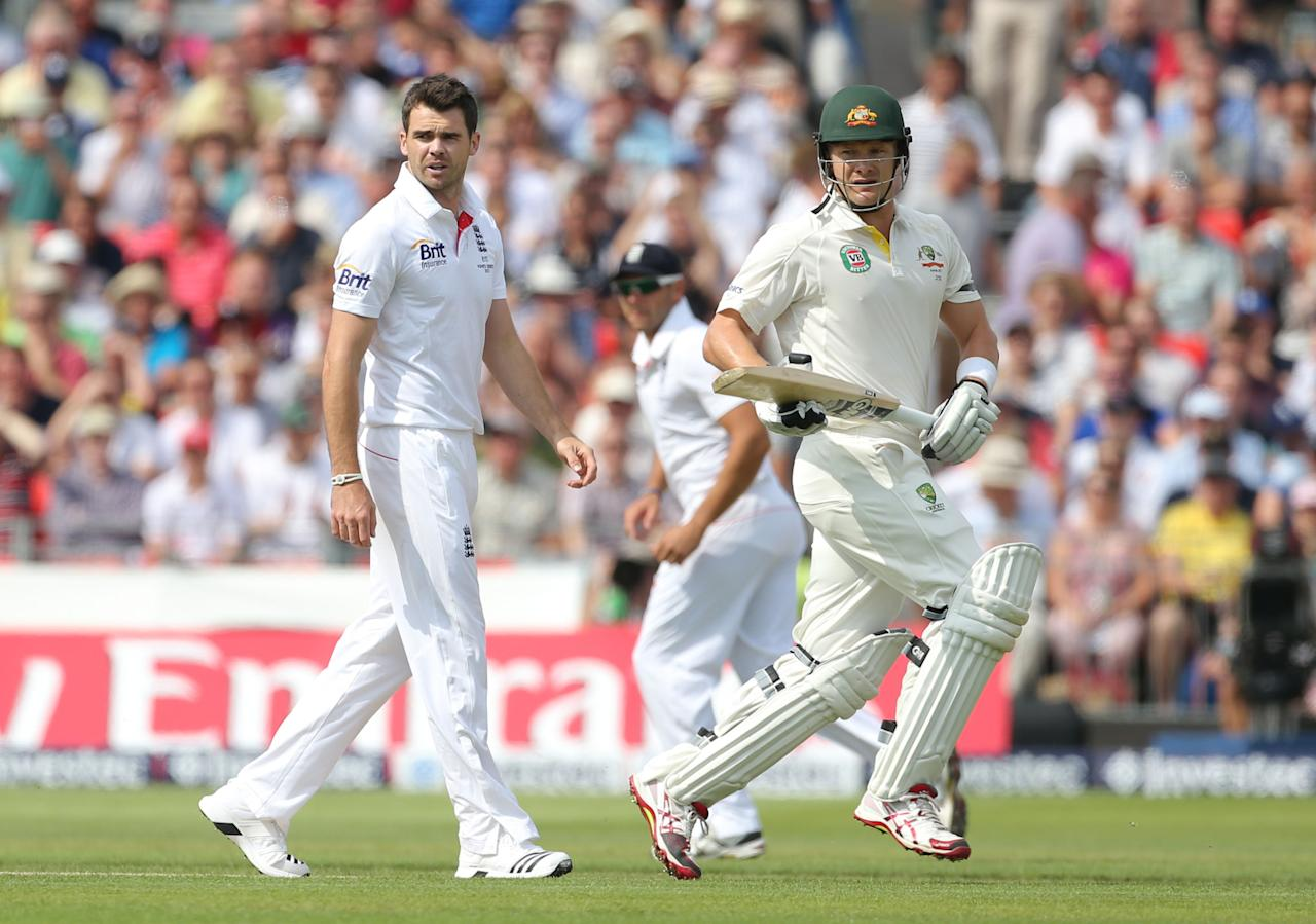 Australia's Shane Watson takes an early run off England bowler James Anderson during day one of he Third Investec Ashes test match at Old Trafford Cricket Ground, Manchester.