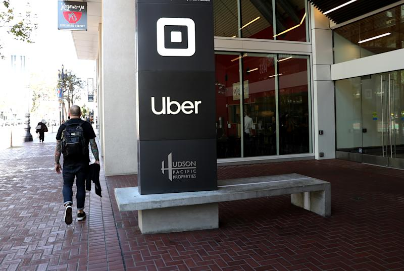 SAN FRANCISCO, CALIFORNIA - SEPTEMBER 23: A pedestrian walks by Uber headquarters on September 23, 2019 in San Francisco, California. Uber's valuation could face an uncertain future after California Assembly Bill AB5 was passed earlier this month and signed by California Gov. Gavin Newsom. The bill could force Uber to reclassify contract workers as employees. The new aw is set to go into effect in January 2020. (Photo by Justin Sullivan/Getty Images)