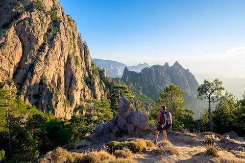 Late spring is an excellent time to conquer Corsica's spectacular inland scenery - Credit: This content is subject to copyright./GUIZIOU Franck / hemis.fr