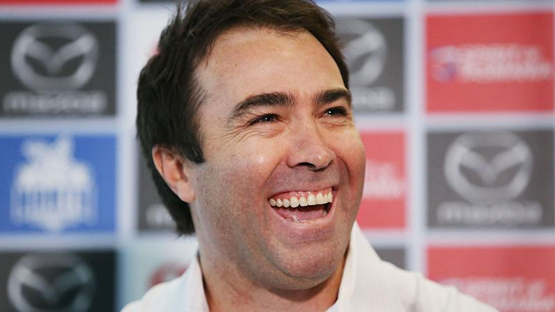 Pictured here, former North Melbourne coach Brad Scott's role with the AFL is set to change.