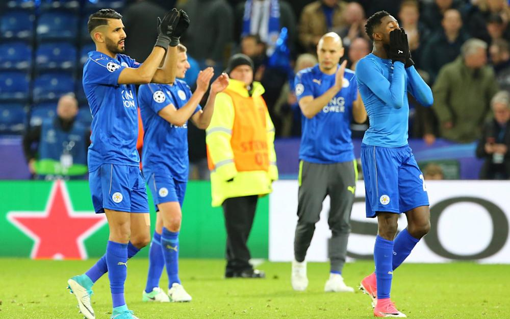 Leicester player Riyad Mahrez (L) and teammates applaud fans after the UEFA Champions League quarter final second leg match between Leicester City and Atletico Madrid - Credit: EPA