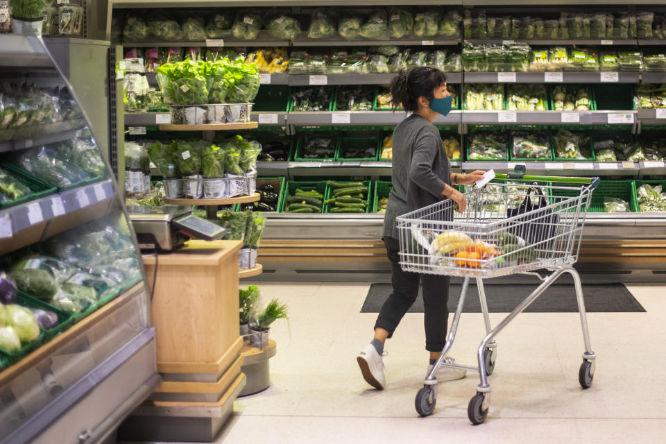 A shopper wearing a face mask in a supermarket in East London as face coverings become mandatory in shops and supermarkets in England. (Photo by Victoria Jones/PA Images via Getty Images)
