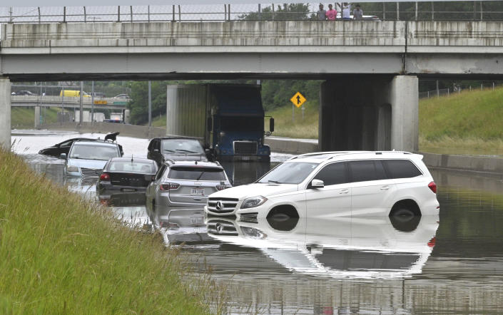 Cars sit in floodwaters on Interstate 94 at 30th Street in Detroit on Saturday, June 26, 2021 after heavy rain hit the metro area. (Max Ortiz/Detroit News via AP)
