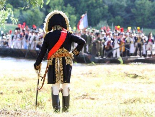 Paris Sorbonne University's professor Oleg Sokolov stands with his sabre and looks at his troops on June 23 on the banks of the river Neman in Kaunas, central Lithuania, as he plays Napoleon Bonaparte during a historical reenactment of Bonaparte's June 24, 1812 assault on Tsarist Russia