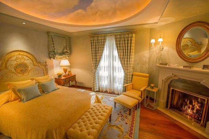 <p>Sweet dreams are inspired by the heavenly mural in the dome over the bed in what's designated the ladies' guest suite. The suite opens onto a private courtyard. (Photo by Steve Brown/Sepia Productions)</p>