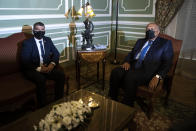 Egyptian Foreign Minister Sameh Shoukry, right, meets with Israeli Foreign Minister Gabi Ashkenazi, at the Tahrir Palace in Cairo, Egypt, Sunday, May 30, 2021. (AP Photo/Nariman El-Mofty)
